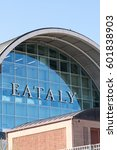 Small photo of Rome, Italy - March 11, 2017: Arch-shaped exterior of Eataly building. Eataly is the upscale food emporium chain; Rome branch opened in 2012 in abandoned air terminal near Ostiense train station
