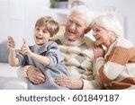 boy using tablet device  taking ... | Shutterstock . vector #601849187