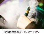 young vaper man with beard... | Shutterstock . vector #601947497