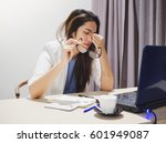 Small photo of Asian woman got headache from working on notebook all day long
