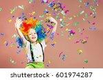 little boy in clown wig jumping ... | Shutterstock . vector #601974287