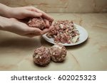 Women's Hands Make Meatballs O...