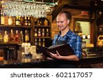 portrait of cheerful barman... | Shutterstock . vector #602117057