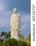 white standing buddha   Shutterstock . vector #602131727