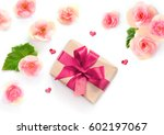 Gift Box With Red Ribbon And...