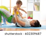 happy mother and child toddler...   Shutterstock . vector #602309687
