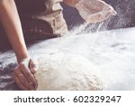 making dough by female hands at ...   Shutterstock . vector #602329247
