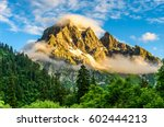 Stock photo mountain peaks in fog scenery landscape 602444213