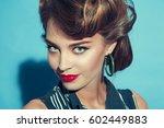 portrait of beautiful girl with ... | Shutterstock . vector #602449883