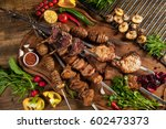kebab  chicken wings  potato on ... | Shutterstock . vector #602473373