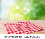 red picnic cloth folded on... | Shutterstock . vector #602500163