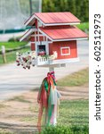 Small photo of joss house Spirit House ( Thai call san phra phum) is surrounded by a beautiful natural radiance in Thailand.