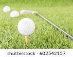 golf ball sitting on tee... | Shutterstock . vector #602542157