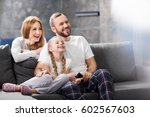 happy family sitting on sofa... | Shutterstock . vector #602567603