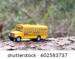 school bus with tree trunk and... | Shutterstock . vector #602583737