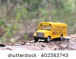 School Bus With Tree Trunk And...