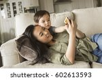 woman lying on a sofa  smiling  ... | Shutterstock . vector #602613593