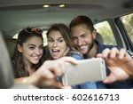 a group of people inside a car  ... | Shutterstock . vector #602616713