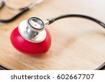 red heart and a stethoscope on...   Shutterstock . vector #602667707