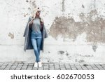 hipster girl wearing blank gray ... | Shutterstock . vector #602670053