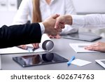 business people shaking hands... | Shutterstock . vector #602674763