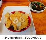 delicious fish cake soup | Shutterstock . vector #602698073