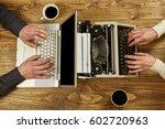 Woman Writing On A Typewriter...