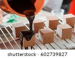 pouring thick chocolate syrup... | Shutterstock . vector #602739827