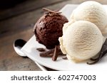 Stock photo close up still life of scoops of chocolate and vanilla ice cream with chocolate shavings and 602747003