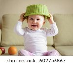cheerful baby girl plays with... | Shutterstock . vector #602756867