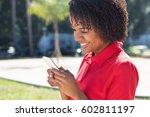 african american woman using... | Shutterstock . vector #602811197