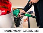 pumping gas at petrol station | Shutterstock . vector #602837633