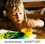 Little Cute Boy Painting At...