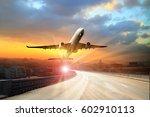 passenger plane fly up over... | Shutterstock . vector #602910113