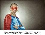 senior superhero man in blue... | Shutterstock . vector #602967653