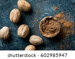 nutmeg on dark background ... | Shutterstock . vector #602985947