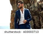 man in elegant suite posing in... | Shutterstock . vector #603003713