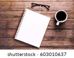 blank notebook  on the coffee... | Shutterstock . vector #603010637