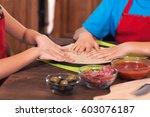 kids preparing a pizza  ... | Shutterstock . vector #603076187