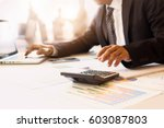 business man hand pointing at... | Shutterstock . vector #603087803