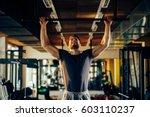 handsome man doing exercise for ...   Shutterstock . vector #603110237