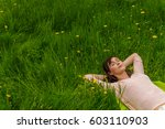 relaxing female lying in high... | Shutterstock . vector #603110903