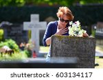woman grieving at cemetery... | Shutterstock . vector #603134117