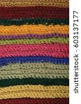 Small photo of Knitted fine wool garment colorful stripes background natural texture, yellow, beige, claret, pink, blue, green scarf macro closeup, large detailed textured knit vertical pattern, horizontal woolen