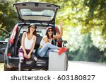 two young women with suitcases... | Shutterstock . vector #603180827