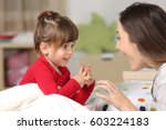 mother and toddler wearing red... | Shutterstock . vector #603224183