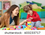 mother and daughter playing... | Shutterstock . vector #603233717