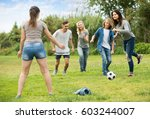 teenagers happily playing... | Shutterstock . vector #603244007