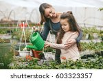 mother and daughter taking care ... | Shutterstock . vector #603323357