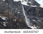 spring avalanche from towering... | Shutterstock . vector #603333767